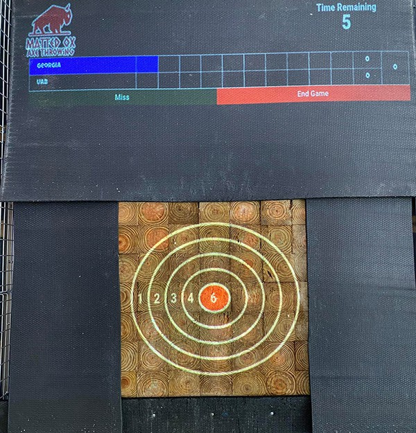 Projected axe throwing targets at Matted Ox in Brunswick